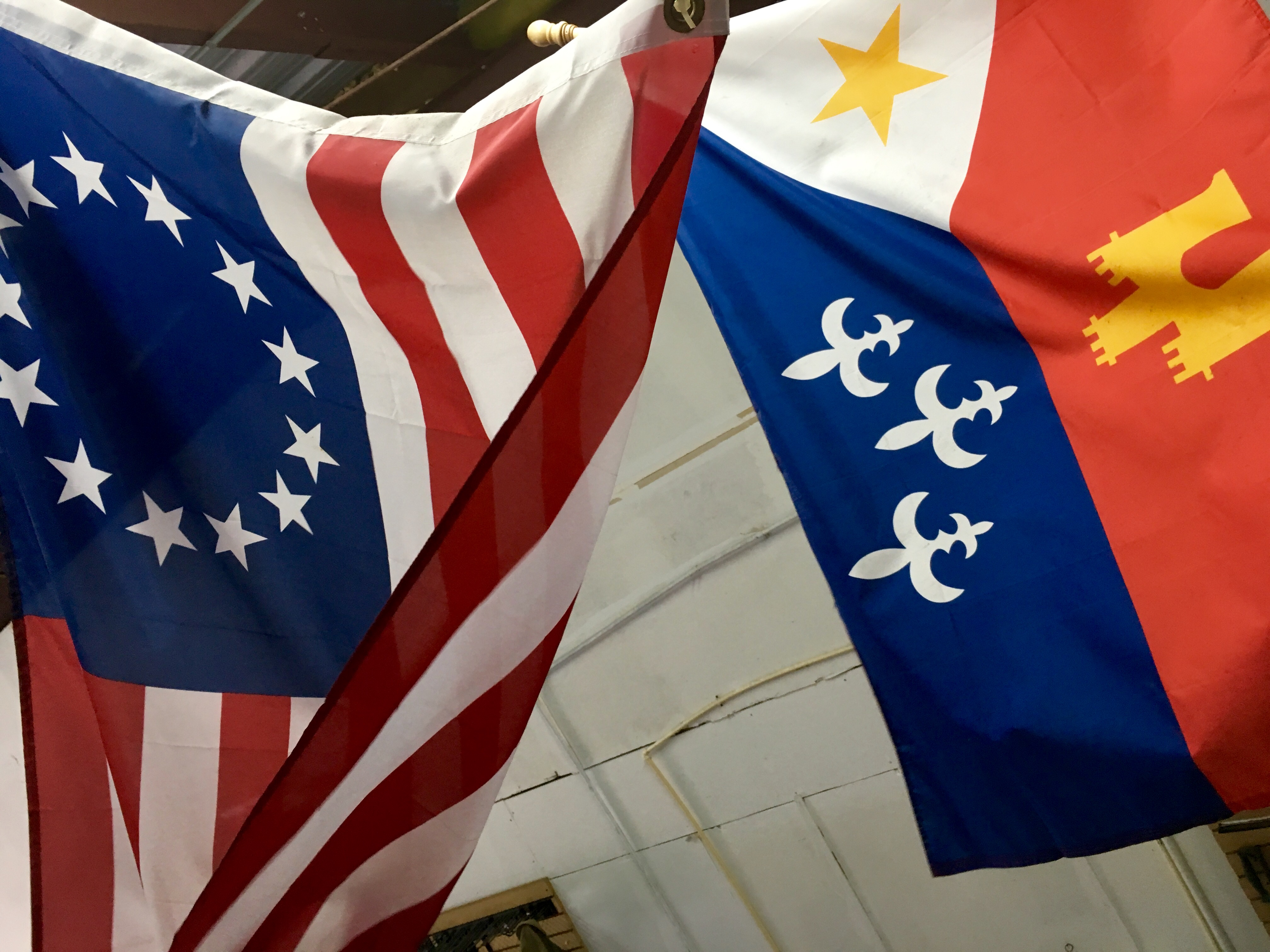 Two flags fly from the inside balcony of Rank Wildcat Spirits.
