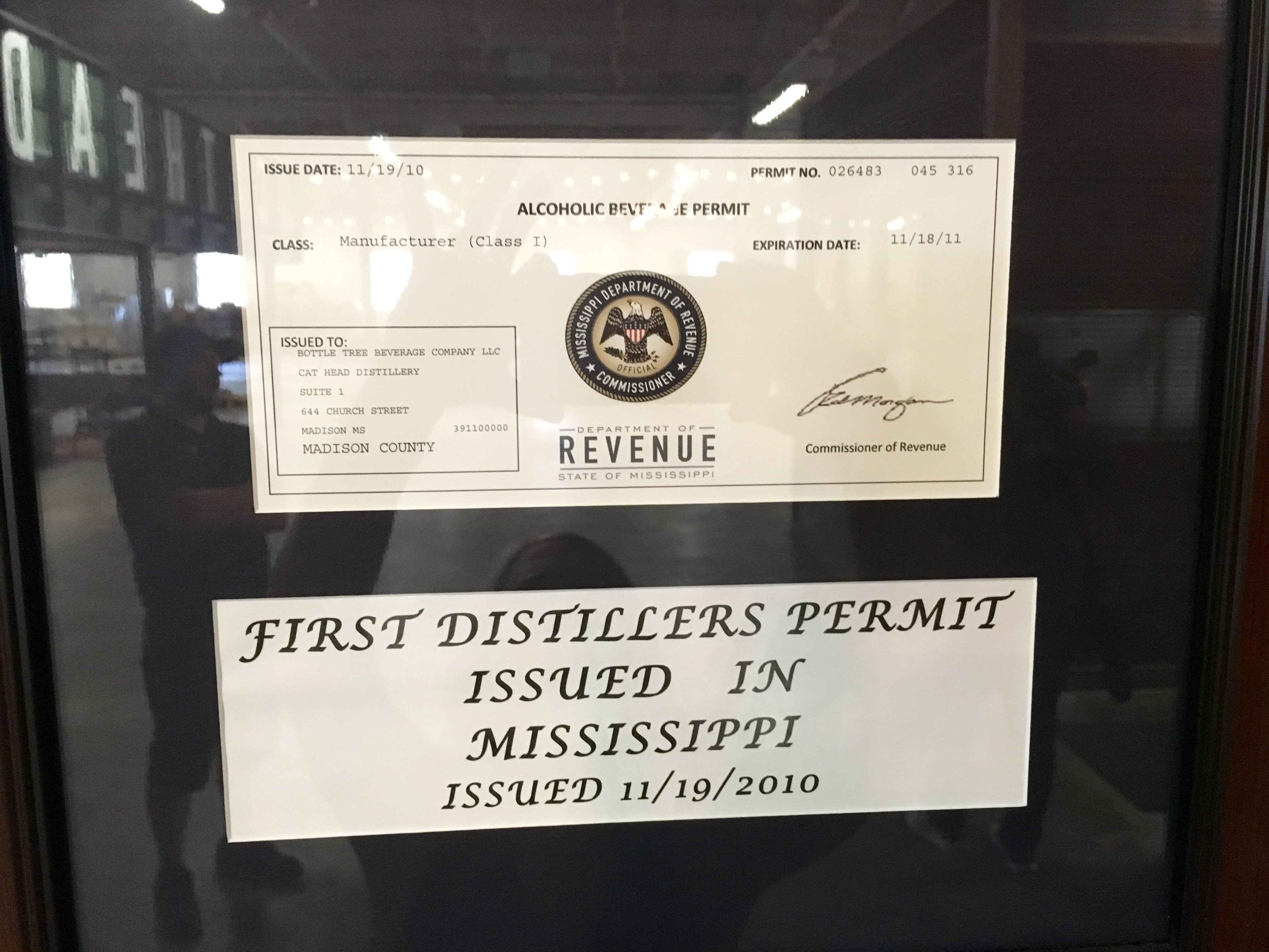 Mississippi's first distiller's permit hangs on the wall at Cathead.
