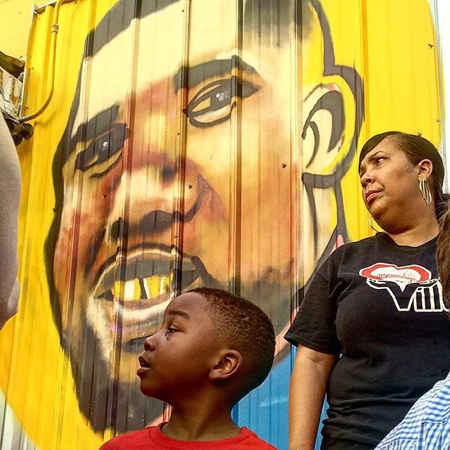 At an vigil for Alton Sterling, an artist painted a mural of Sterling on the wall outside of the store where he was fatally shot by police. Savidge posted the progression of the mural on Instagram. In the latest post, one of Sterling's sons is shown looking at a picture of his father in front of the mural. (Martin Savidge/CNN)