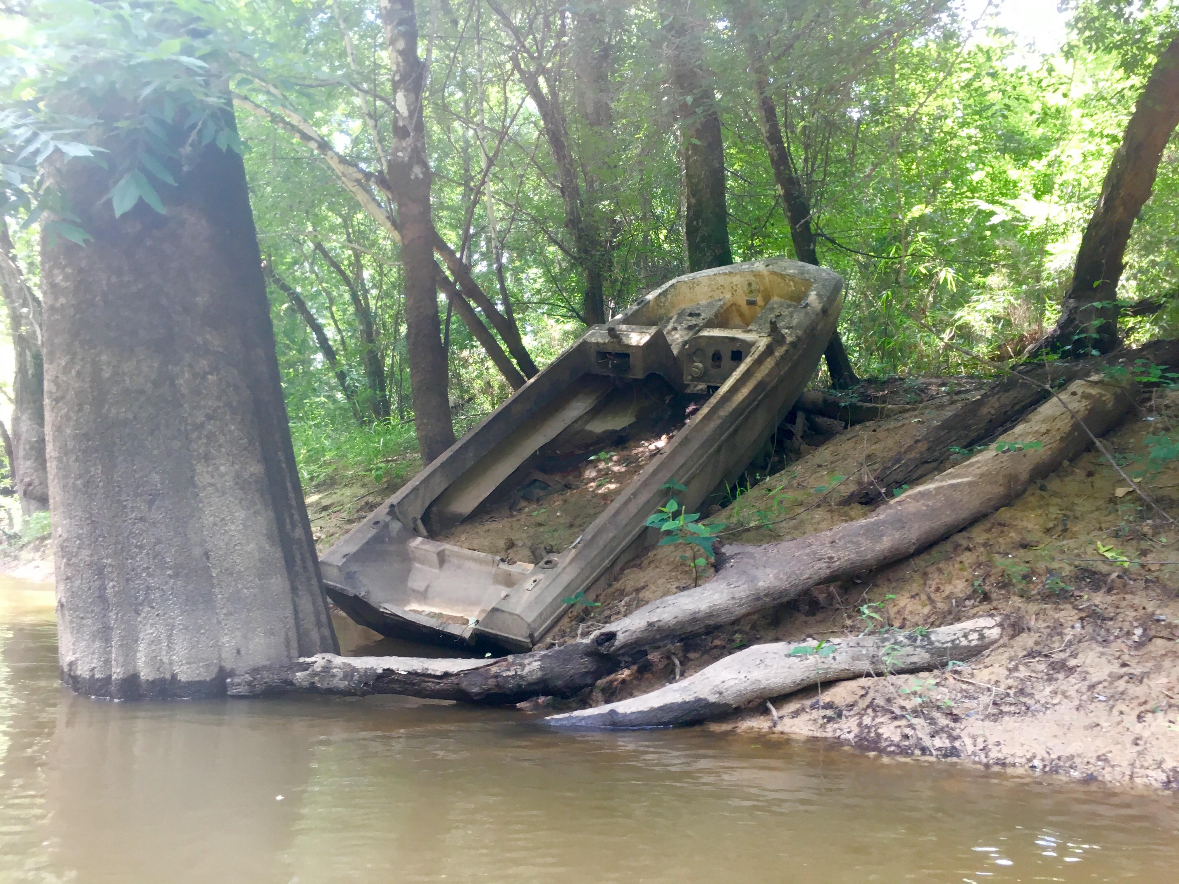 Katrina turned the river bank into a boat graveyard.