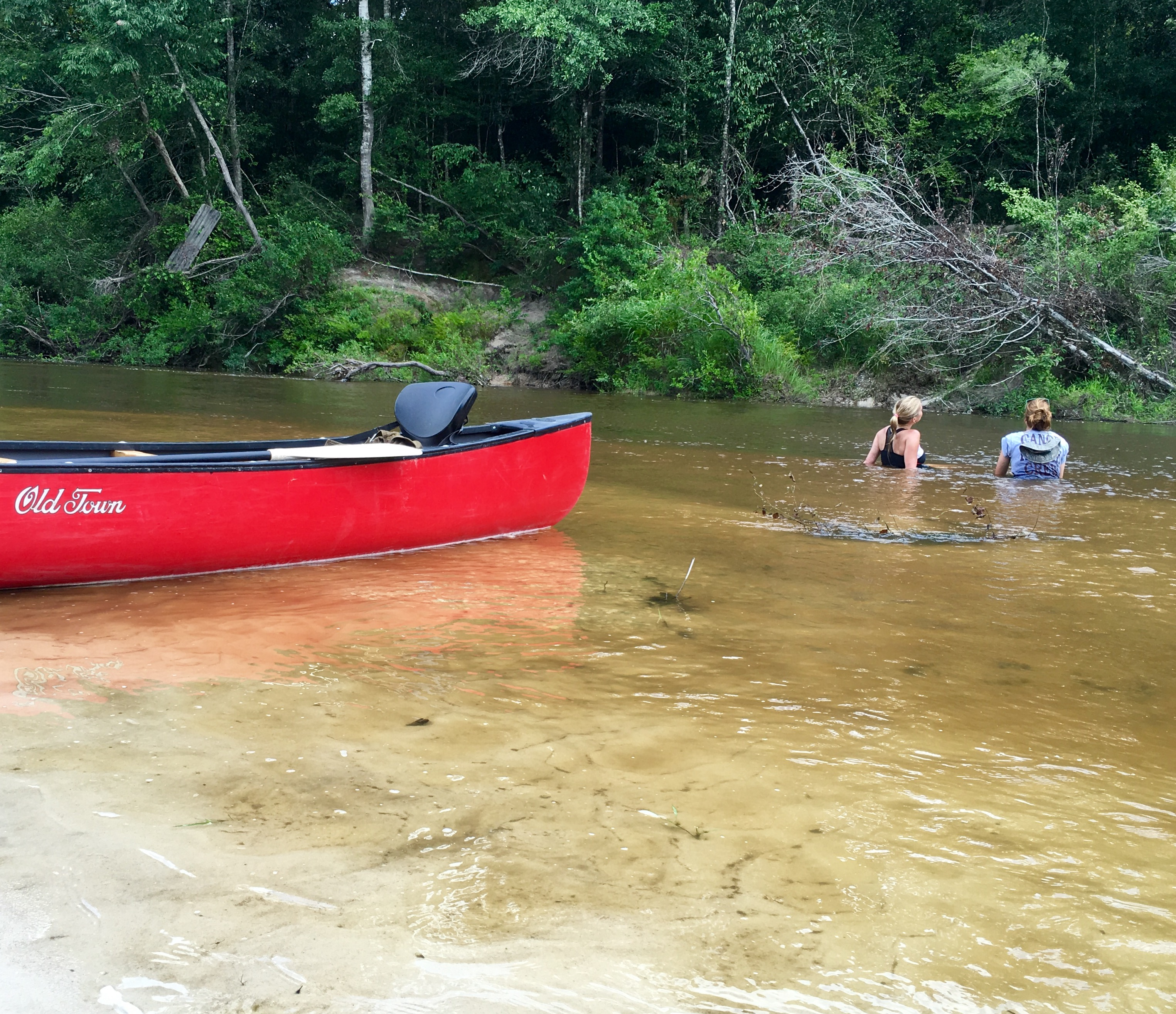 WGNO Travel Girl Stephanie Oswald and guide Joanna Dorris cooling off in the Wolf River.
