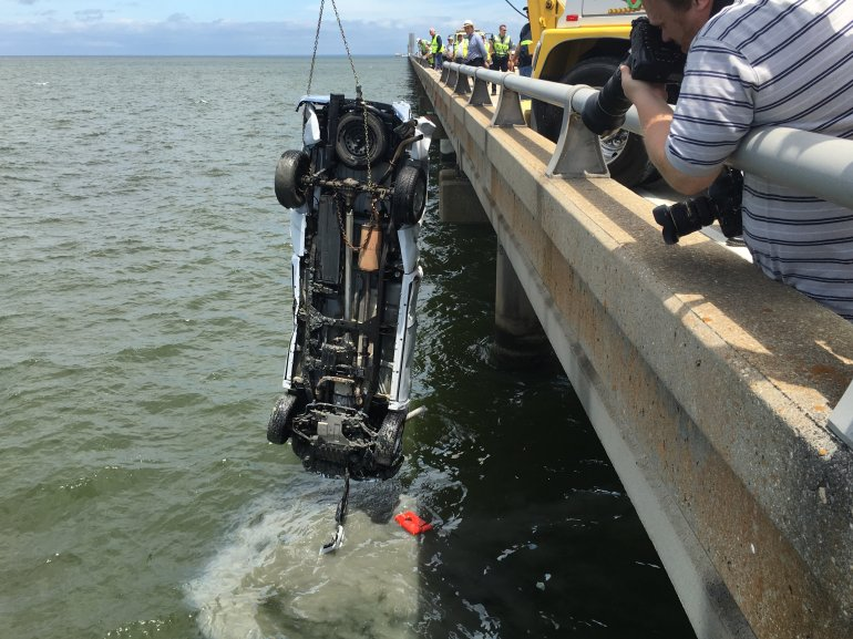 Pick-up truck pulled from Lake Pontchartrain Monday, August 8, after morning accident sent it overboard. (WGNO/ Derek Felton)