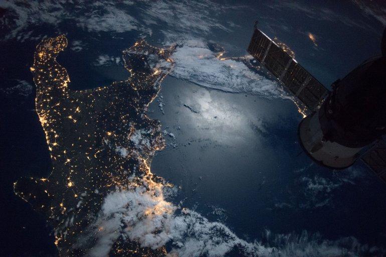 Moon's Reflection off of the Italian Peninsula and the Mediterranean Sea Courtesy: NASA.gov