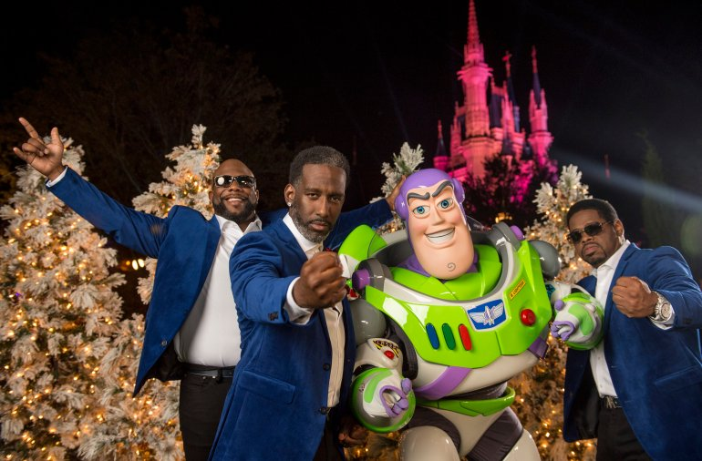 "LAKE BUENA VISTA, FL - NOVEMBER 09:  In this handout photo provided by Disney Parks, (L-R) Wanya Morris, Shawn Stockman and Nathan Morris of R&B group Boyz II Men pose with Buzz Lightyear during a break from taping of the Thanksgiving TV special, ""The Wonderful World of Disney: Magical Holiday Celebration"", in Magic Kingdom Park at Walt Disney World Resort on November 9, 2016 in Lake Buena Vista, Florida. The telecast airs nationwide November 24 on ABC-TV. (Photo by Kent Phillips/Disney Parks via Getty Images)"