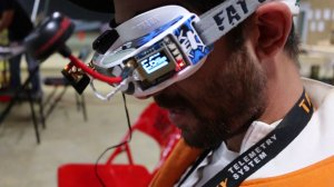 Pilots fly while wearing goggles that only provide a view from their drone's camera