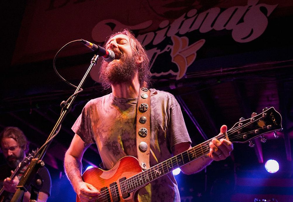 NEW ORLEANS, LA - MAY 03: (L-R): Neal Casal, Chris Robinson and George Sluppick of Chris Robinson Brotherhood perform at Tipitina's on May 3, 2012 in New Orleans, Louisiana.  (Photo by Erika Goldring/Getty Images)