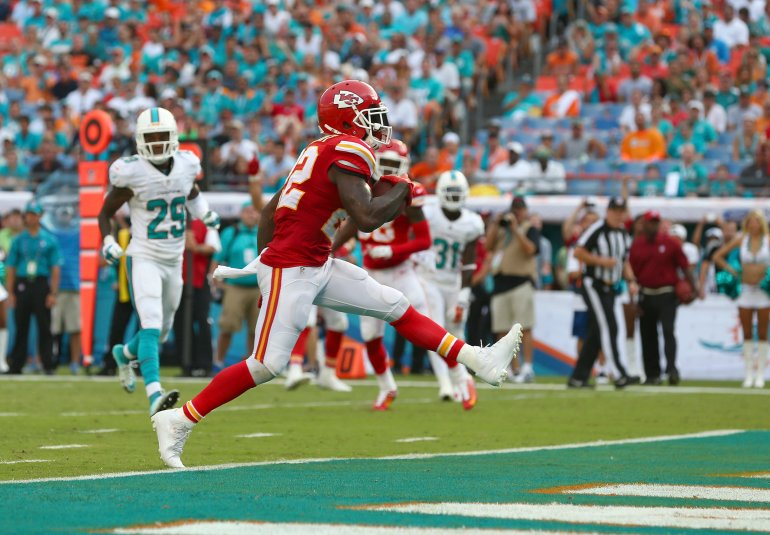 MIAMI GARDENS, FL - SEPTEMBER 21: Running back Joe McKnight #22 of the Kansas City Chiefs scores a third-quarter touchdown against the Miami Dolphins at Sun Life Stadium on September 21, 2014 in Miami Gardens, Florida. (Photo by Ronald Martinez/Getty Images)