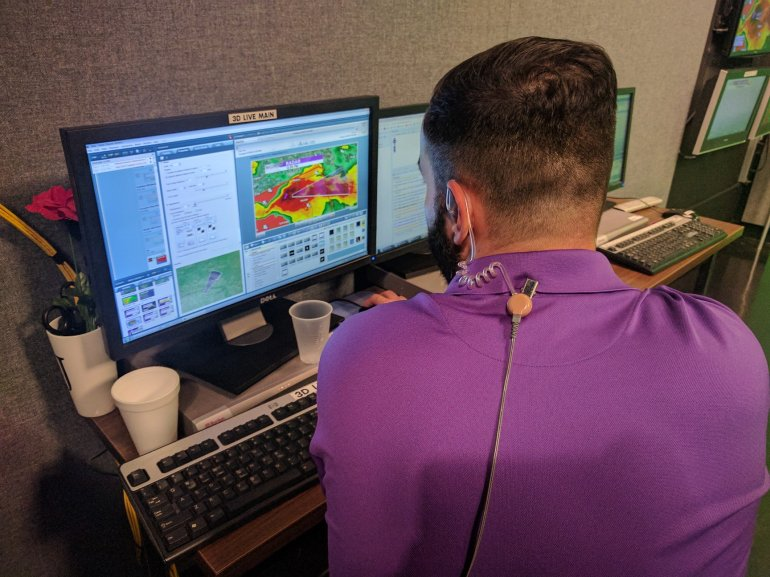 Jason looking at the weather radar