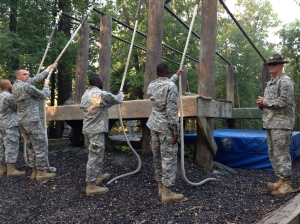 Drill Sergeant Skinner instructing the Privates on how to do each obstacle
