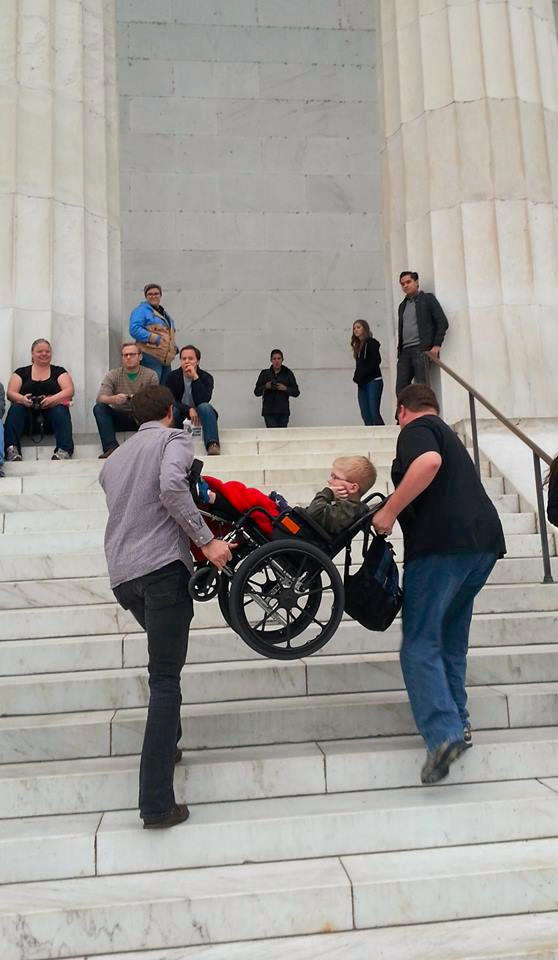 Two men carry Caleb Wortham up the stairs at one of the memorials (Photo: Wortham Family)