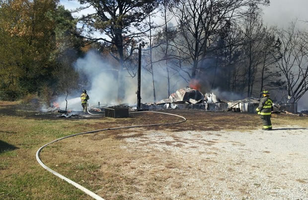 The mobile home on Lawrence County Road 425 was quickly destroyed by fire Monday. (Photo: William Szczpanski/WHNT News 19)