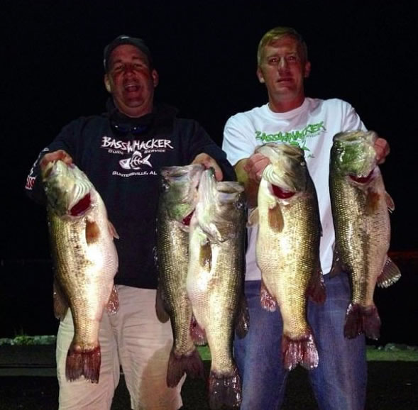 Photo of the two men holding a big catch (Wired2Fish.com, from one of the men's Facebook pages)