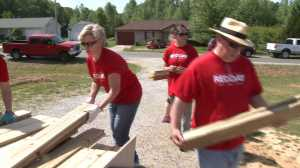 Keller Williams employees build a ramp for a family in Madison County.