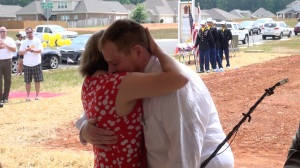 Cpl. Johnson and his wife share an emotional embrace (PHOTO: David Wood, WHNT)