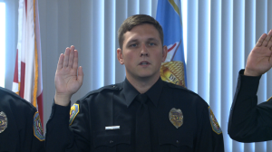 Officer Joshua Williams takes the oath and becomes the third member of his family to wear the Decatur Police Department badge. (Photo: Al Whitaker, WHNT News 19)