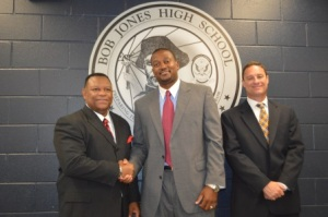 Left to right: Bob Jones Assistant Principal/Athletic Director Luther Tiggs, new girls head basketball coach Andre Reynolds, and Principal Robby Parker.