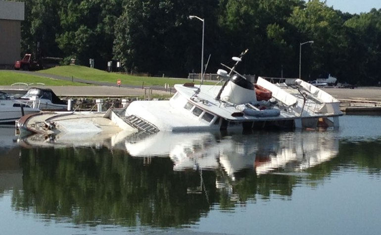 A yacht was found capsized at Ditto Landing on Friday morning. (Photo: Daniela Perallon/WHNT News 19)