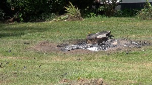 One of five front yard burn piles at the home where Caitlyn Dover took a photo of what she says was a large cross aflame along the highway. (PHOTO: David Wood, WHNT)