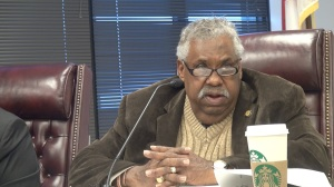 """The role of a county commissioner shall be to take care of roadways, pathways, bridges, orphans and widows,"" Bob Harrison reminded Phil Riddick. (PHOTO: David Wood, WHNT)"