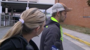 WHNT News 19's Carrie Marchese questions Joshua Harris outside the city inspector's office.