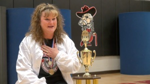 Sparkman High School head cheer coach Lisa Aderholt chokes back tears as she describes the experience of watching her squad, and her senior daughter, bring home national championship gold. (PHOTO: David Wood, WHNT)