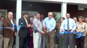 Madison County Commissioner Eddie Sisk and Mayor Butch Taylor cut the ribbon for the grand reopening of New Hope's Senior Center (PHOTO: David Wood, WHNT)