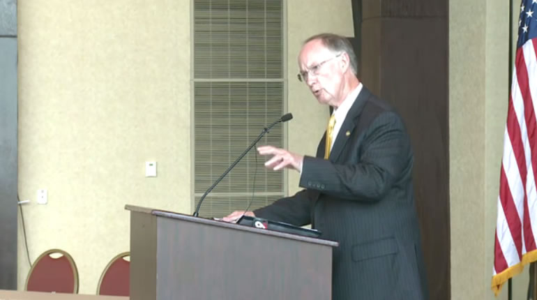 Governor Robert Bentley addresses a crowded room at Lake Guntersville State Park Lodge on Monday, April 20. (Photo: Laura Christmas/WHNT News 19)