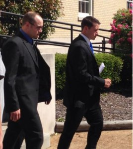 Eric Parker, right, leaves the federal courthouse in Huntsville after a recent appearance. (WHNT News 19)