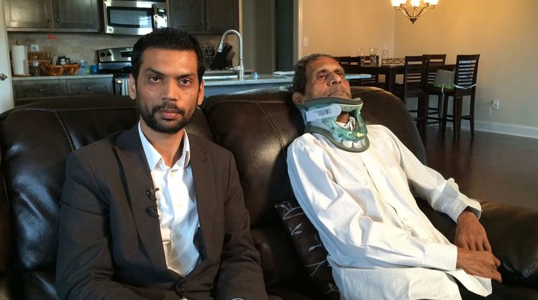 Chirag Patel sits with his father, Sureshbhai, in their home in Madison. (Photo: Melissa Riopka/WHNT News 19)