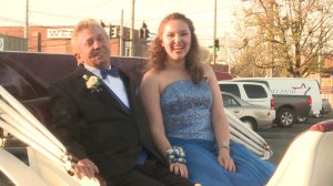 James Drain and his granddaughter, Joy Webb, ride in a horse-drawn carriage to Albertville High School's prom. (Photo: Kelsey Kern/WHNT News 19)