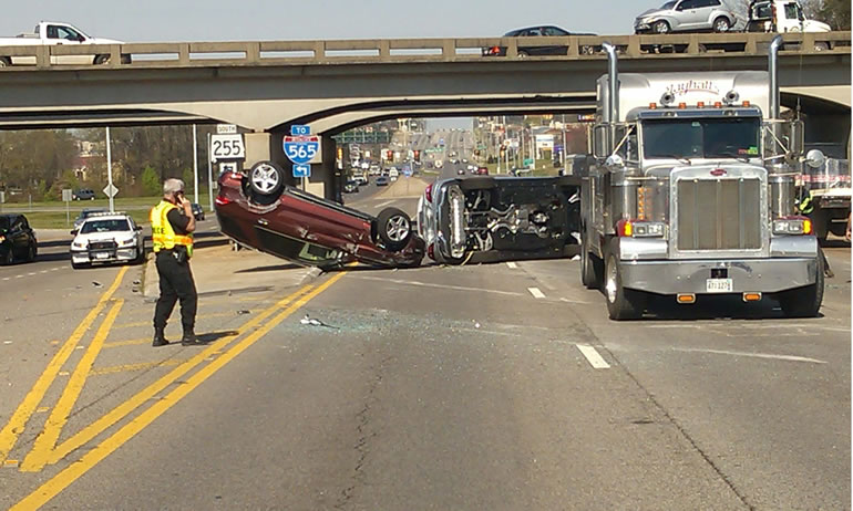 Three Mercedes SUVs came off the tractor-trailer on University Drive around 9:30 a.m. Wednesday. (Photo: David Schmidt/WHNT News 19)