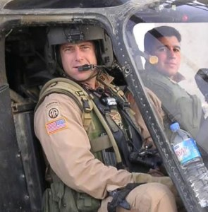 Chris Chance, left, in a OH-58D Kiowa Warrior helicopter. The man on the right died serving his country.