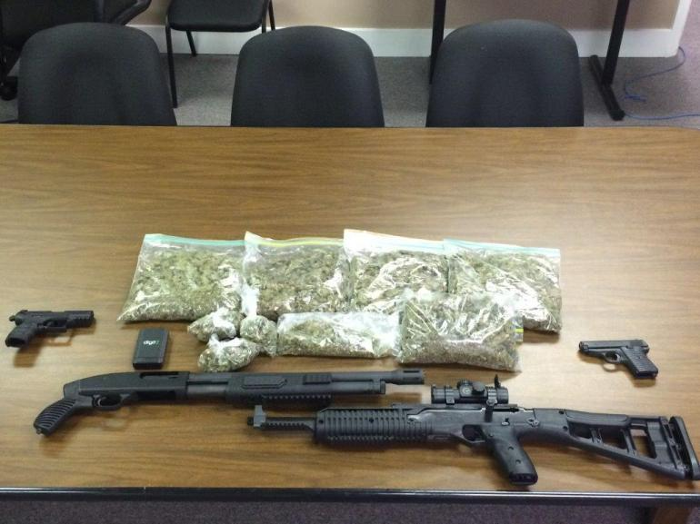 A photo of marijuana and weapons Huntsville police officers say they confiscated from an apartment on Triana Boulevard. (Photo provided by: Huntsville Police Department.)