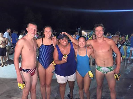 Coach Kathy Williams (center) with her Byrd Spring age 15-17 mixed relay 200-yard freestyle record breakers (from left) Joe Hinely, Mary Northcutt, Chloe Hui and Sam Vasquez. (Photo: Elizabeth Hinely)