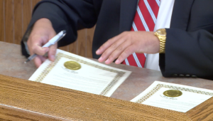 Russellville Mayor David Grissom signs proclamation to honor the champions