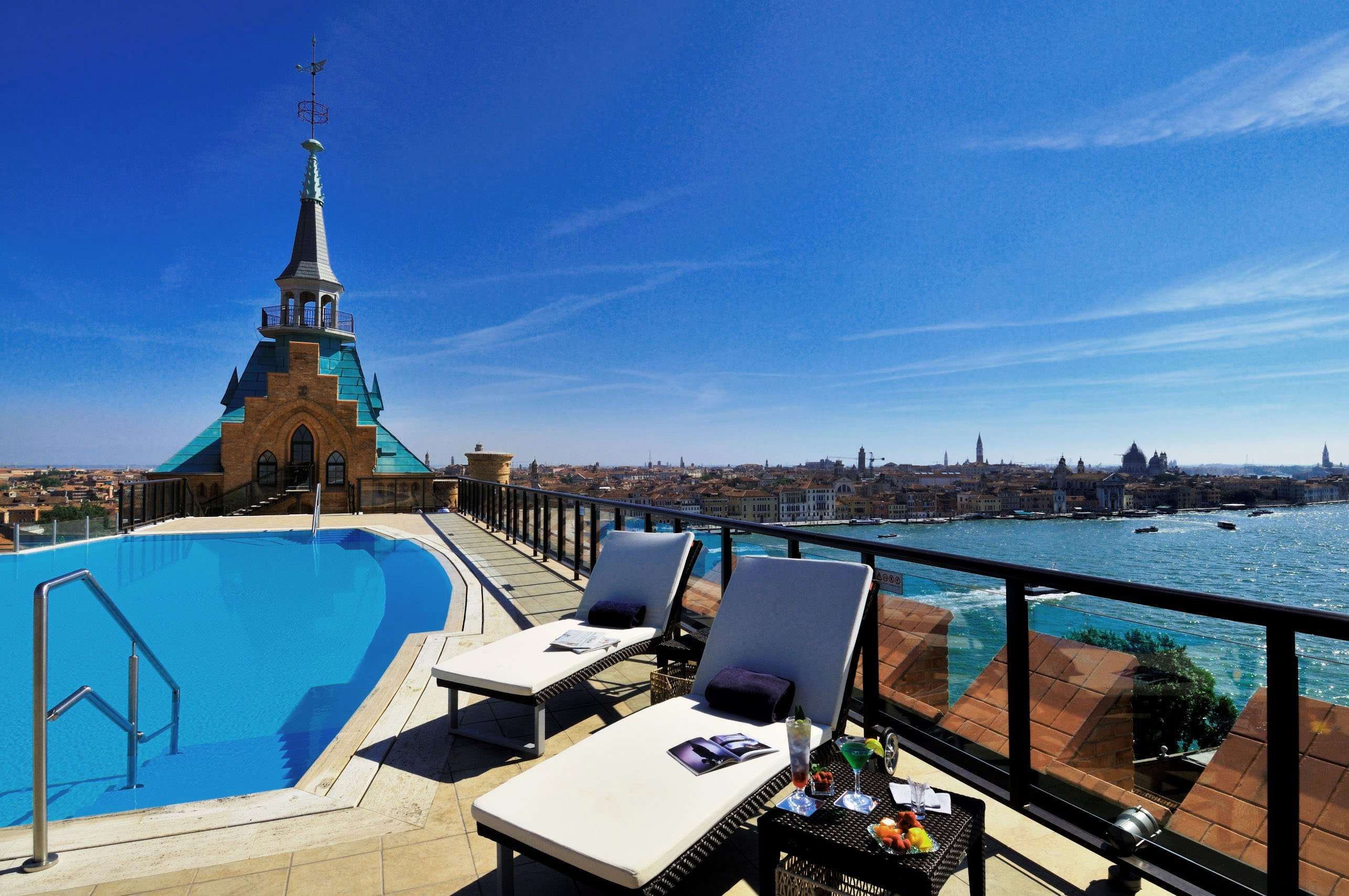 Views of Venice's scenic canals are part of the draw at the Hilton Molino Stucky's rooftop pool.