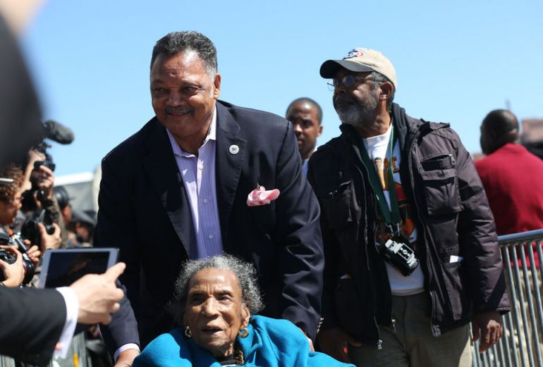 Jesse Jackson arrives in Selma, Ala., with civil rights activist Amelia Boynton Robinson as thousands crowded into downtown Selma, Ala., to hear President Obama speak on the 50th anniversary of Bloody Sunday on Saturday March 7, 2015. Robinson was beaten unconscious on Bloody Sunday on March 7, 1965. (Sharon Steinmann/ssteinmann@al.com)