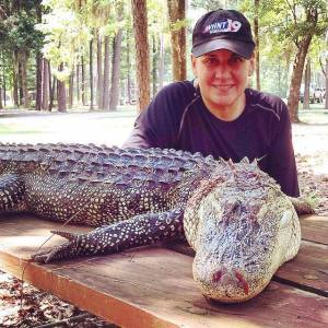 Denise Vickers with the gator she harvested in Alabama's 2015 hunt.