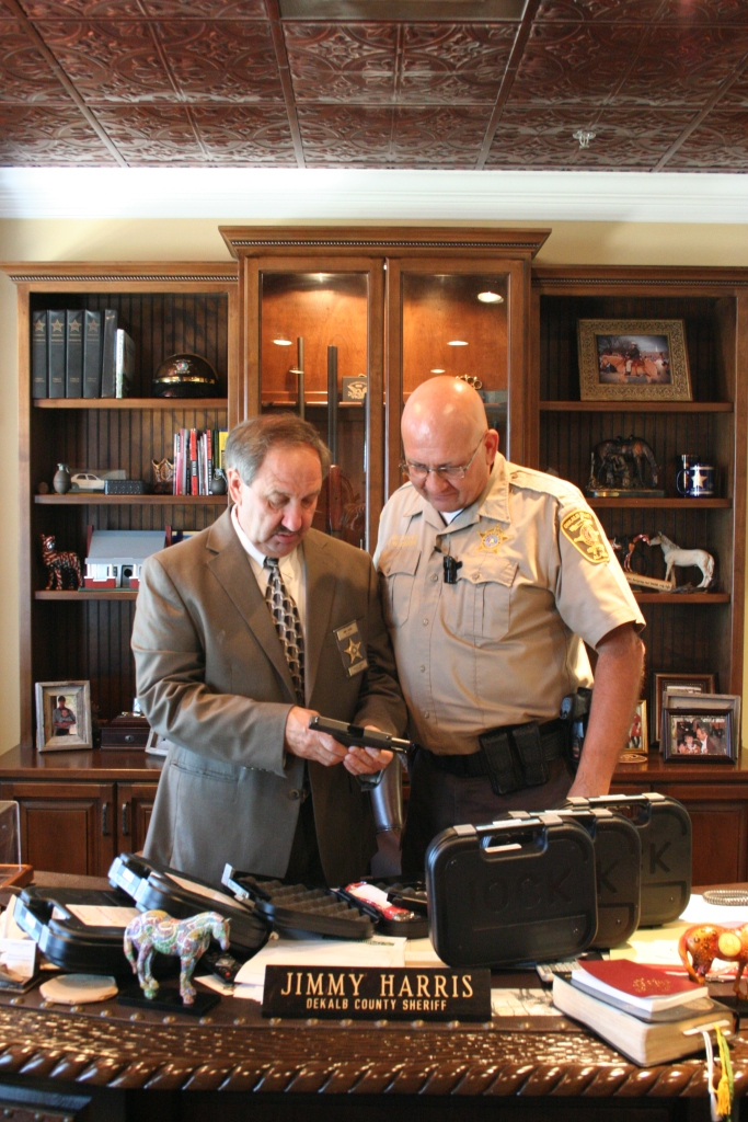 Sheriff Jimmy Harris examines new backup weapon (courtesy: DeKalb County Sheriff's Office)
