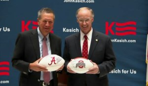 John Kasich and Robert Bentley trade footballs from each other's state.