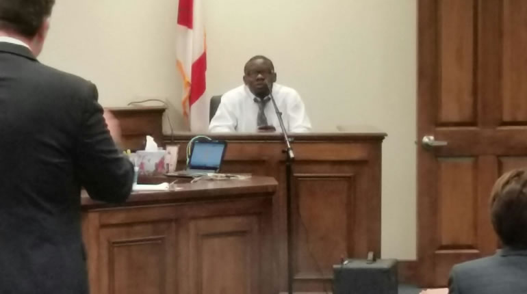 Kuponiyi on the stand Wednesday during his trial. (Photo: David Schmidt/WHNT News 19)
