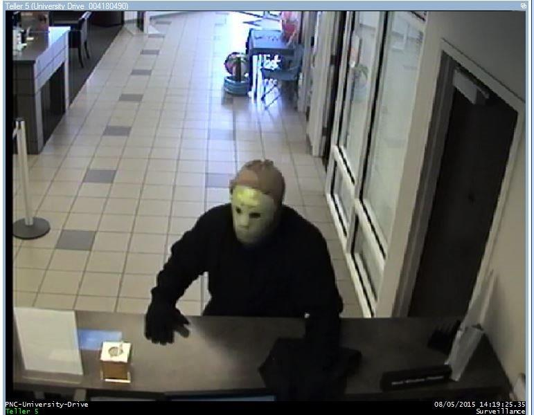 Surveillance photos from PNC Bank robbery (photo from Huntsville PD)