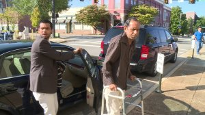 Chirag Patel, left, helps his father, Sureshbhai Patel out of the car before court began Monday morning. (David Schmidt/WHNT News 19)