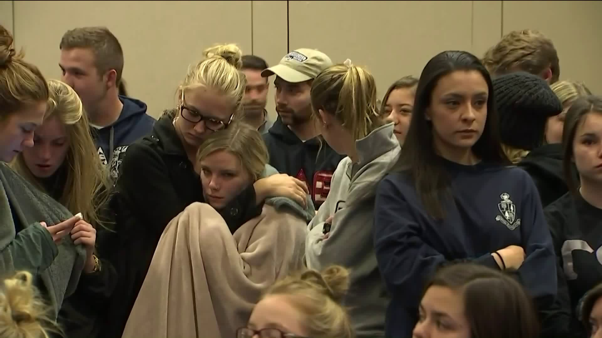 Students comforting each other at the NAU news conference