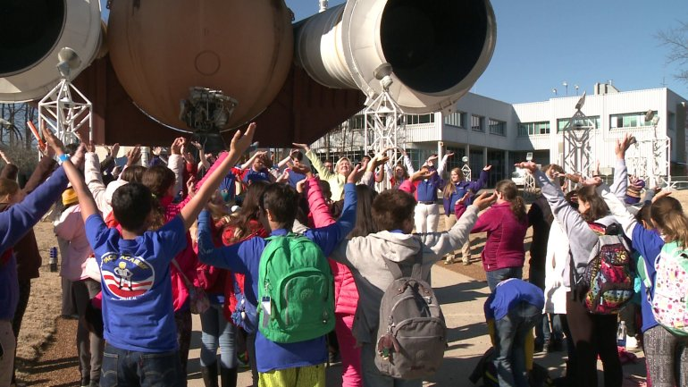 Space Camp students stretch their arms in the form of wings to honor the Challenger astronauts. (Photo: Chris Davis/WHNT News 19)