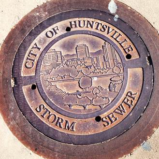 The City of Huntsville has used this design for its standard manhole cover since 2003. (Photo: City of Huntsville)