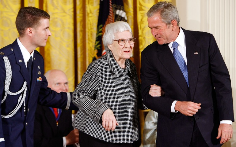 """WASHINGTON - NOVEMBER 05: U.S. President George W. Bush (R) takes Pulitzer Prize winner and """"To Kill A Mockingbird"""" author Harper Lee (C) by the arm before presenting her with the 2007 Presidential Medal of Freedom in the East Room of the White House November 5, 2007 in Washington, DC. The Medal of Freedom is given to those who have made remarkable contributions to the security or national interests of the United States, world peace, culture, or other private or public endeavors. (Photo by Chip Somodevilla/Getty Images)"""