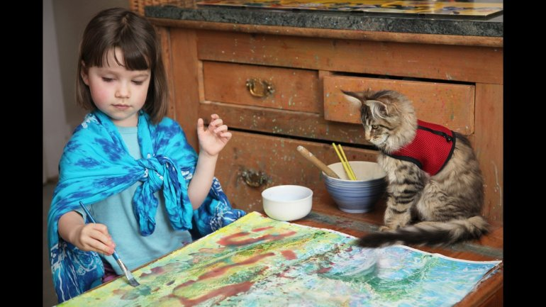 Six-year-old Iris Grace Halmshaw, who has autism, immediately bonded with Thula when her parents brought the affectionate Maine Coon kitten home two years ago. Because being indoors can be distracting for Iris, her mother, Arabella Carter-Johnson, creates outdoor classrooms so that she can homeschool her daughter in a peaceful environment that encourages her to retain information. Thula also participates.
