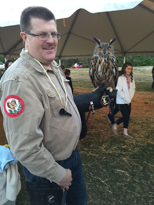 Curt Cearley of the Rise Raptor Project holds Maximus, a Eurasian Eagle-owl. (Photo: Claire Aiello/WHNT News 19)