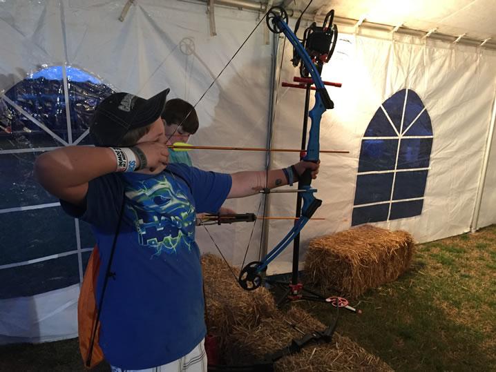 Thomas Dinca, 10, fine-tunes his archery skills. He did pretty well! (Photo: Claire Aiello/WHNT News 19)